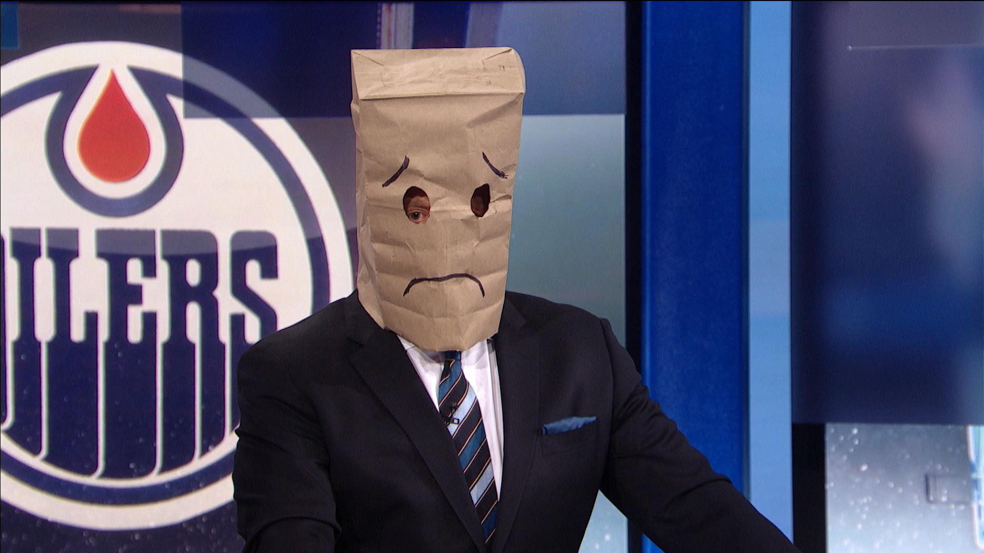 Jeremy Roenick dons paper bag over his head after Oilers' loss