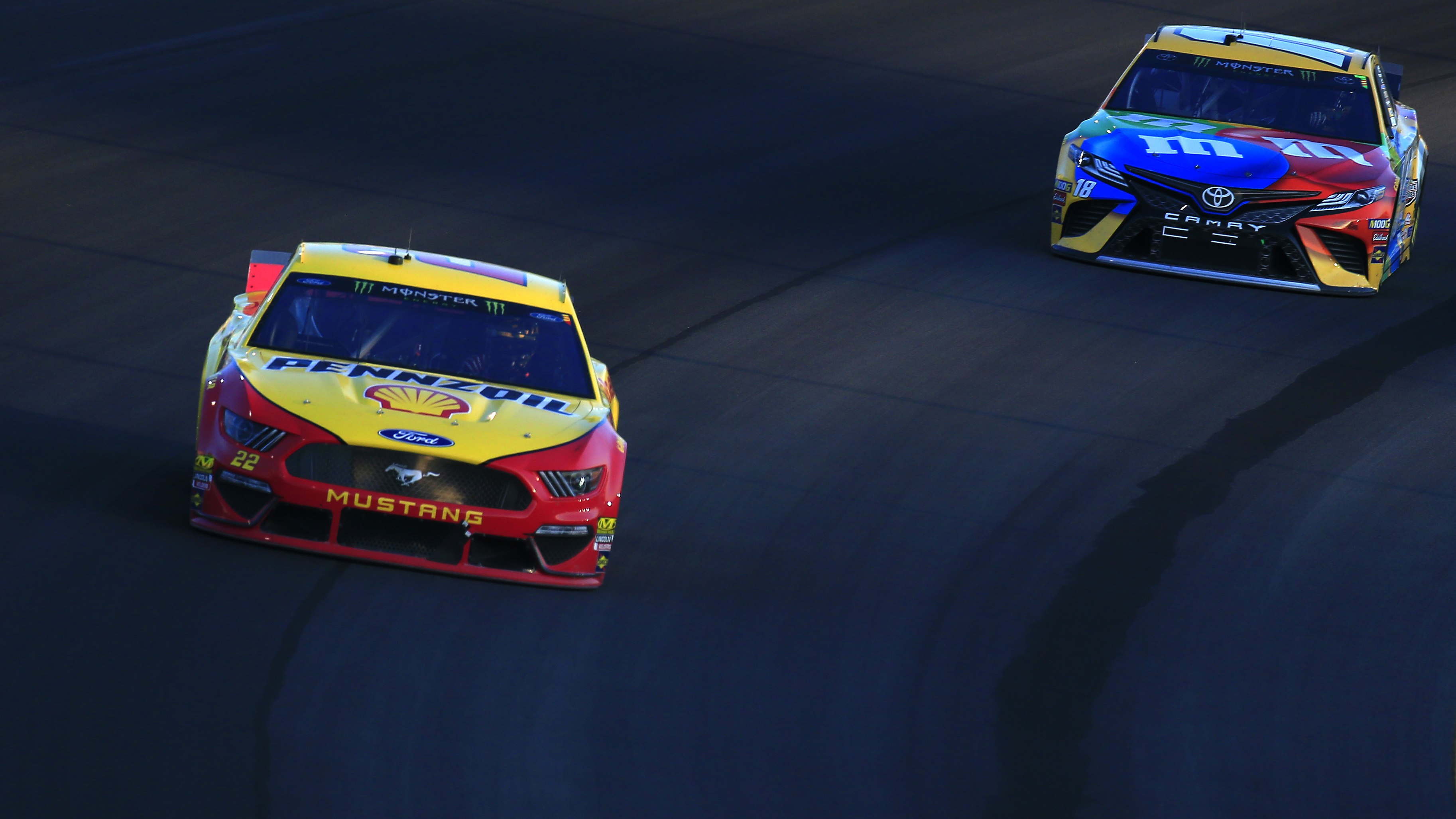 Kyle Busch and Joey Logano battle for position in final laps at